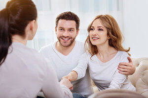 A woman shakes a counselors hand at the start of an intensive family therapy session