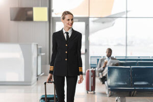 A woman returns to work after receiving addiction treatment for pilots